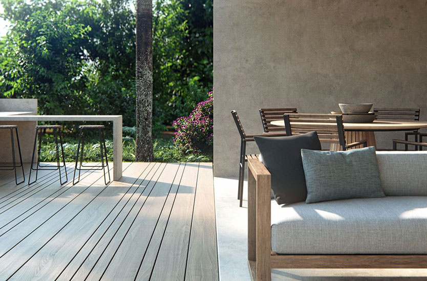 3D photorealistic architectural visualization of a residential exterior with ipe deck, concrete patio, and custom seating