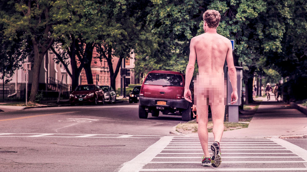 Naked man with tennis shoes crossing the street at a crosswalk, signifying that you should only commit to a price point once the scope is understood.
