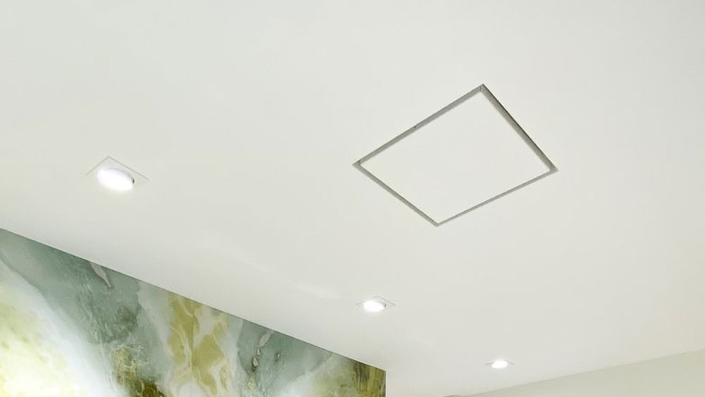 Aria Drywall Pro X - Exhaust fan and air return covers showing a seamless smooth finish customized to match your walls and ceilings.