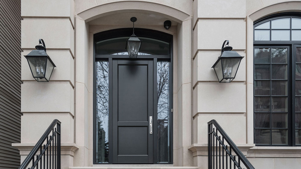 Single entry, modern solid wood door with full undivided sidelites and transom shows that an entry door doesn't have to be big to be impressive.