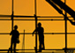 Silhouette of two construction workers on scaffolding, signifying the current condition of the architectural and construction industries.