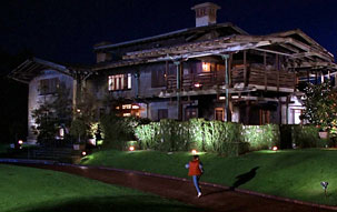 Marty McFly running up the driveway of the 3-story arts and crafts style Gamble House, used as the set for the home of Doc Brown in Back to the Future