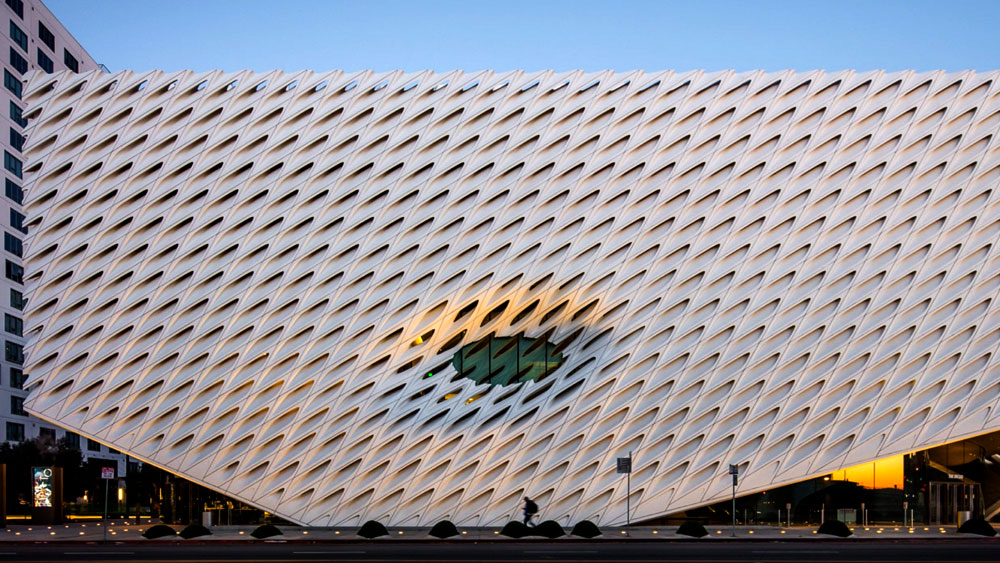 Evening photo of The Broad, contemporary art museum in Los Angeles, with a sculpted glass fiber reinforced concrete exterior