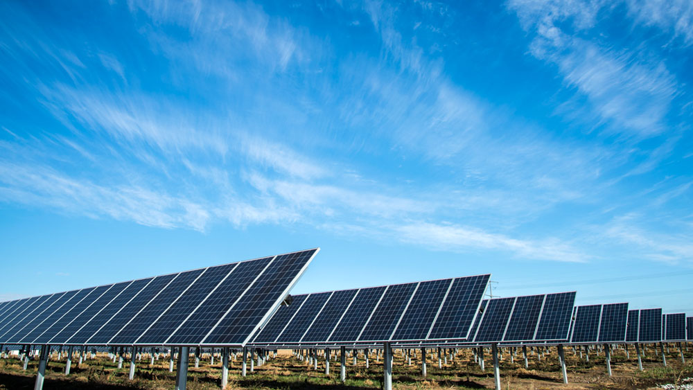An array of solar panels at a Lincoln Electric facility in Lincoln, Nebraska under a blue sky with wispy white clouds