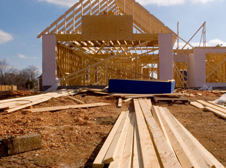 A 2-story wood frame house under construction halted by the COVID-19 global pandemic