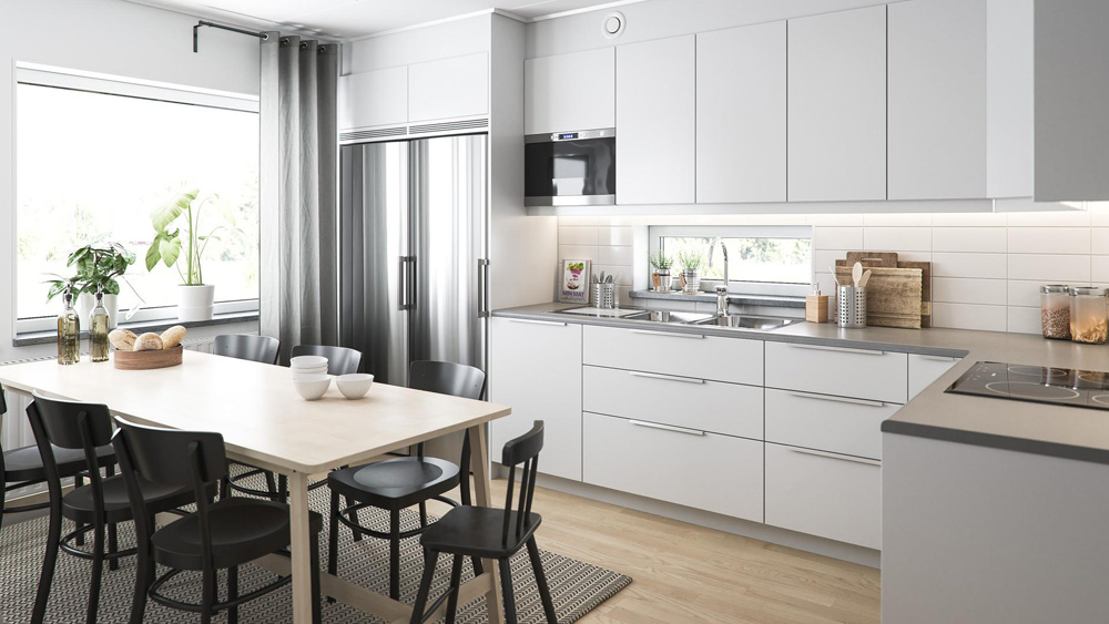 BoKlok home featuring modern white IKEA cabinetry and soapstone grey countertops in an airy kitchen with a large picture window
