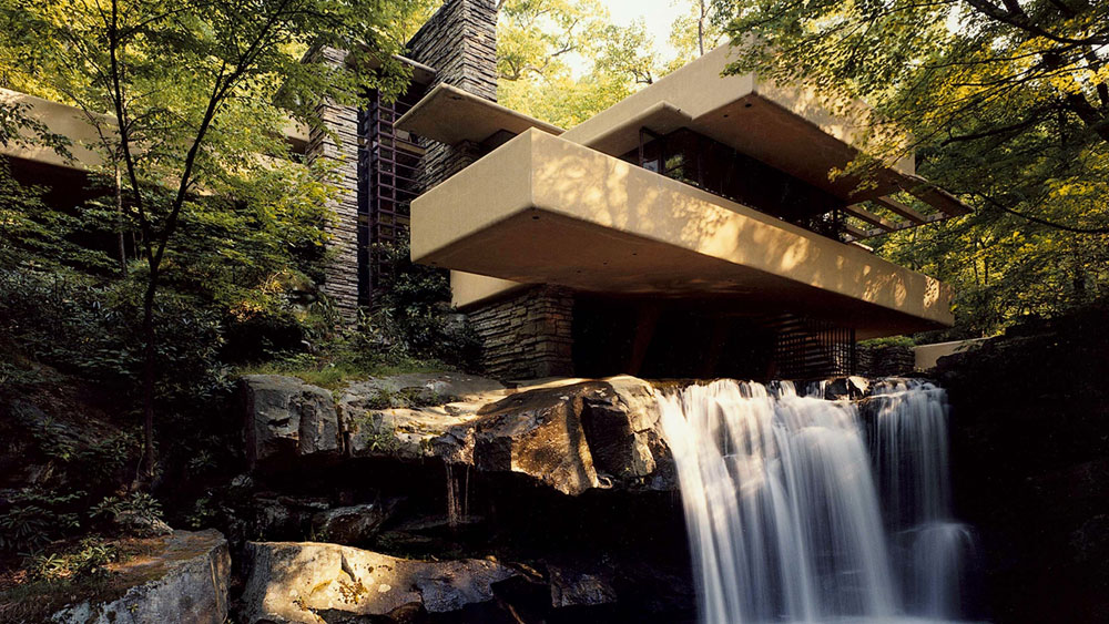 The exterior and waterfall of Frank Lloyd Wright's Fallingwater in Bear Run, PA