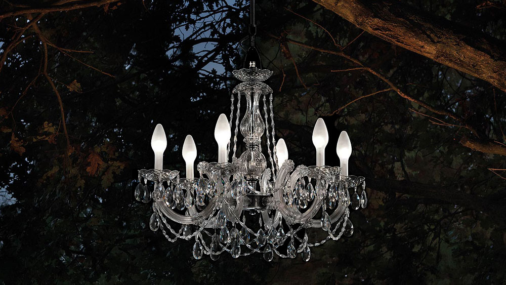 A single tier crystal-looking chandelier made for the outdoors in clear glass with 12 LED lights from Masiero.