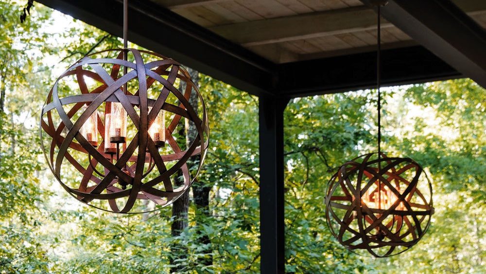Hinkley outdoor chandelier made of flat iron rods formed into an orb, surrounding vintage bulbs in hurricane glass