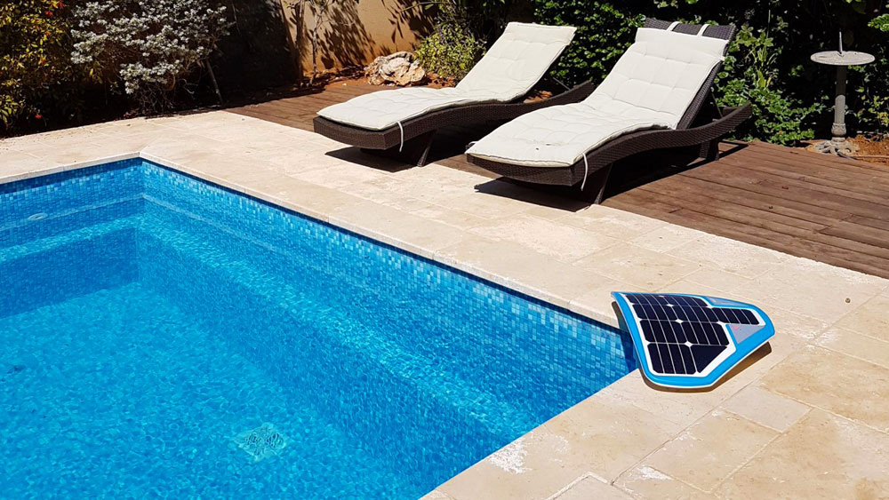 The Coral Manta 3000 placed on the edge of a sunny pool for 24/7 underwater safety monitoring.