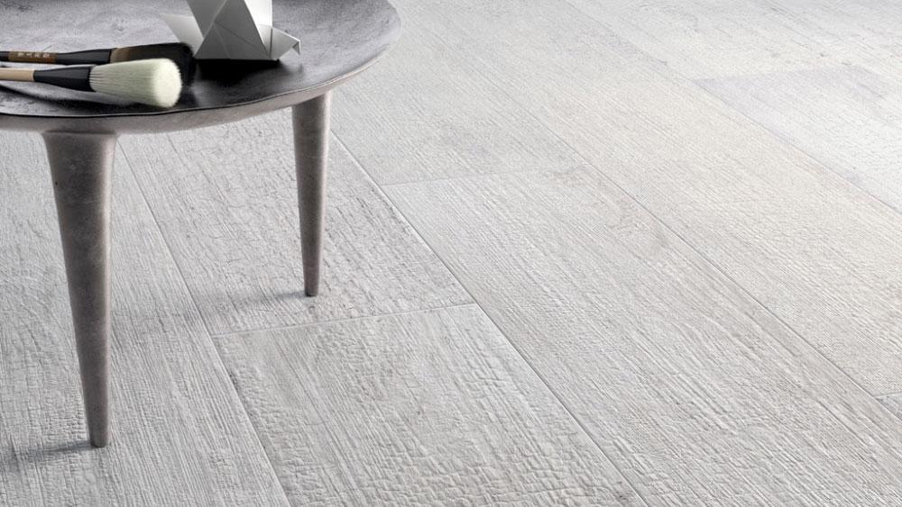 Closeup of Refin's Kasai wood-look tile that emulates a shou sugi ban (charred wood) in a pale white hue.