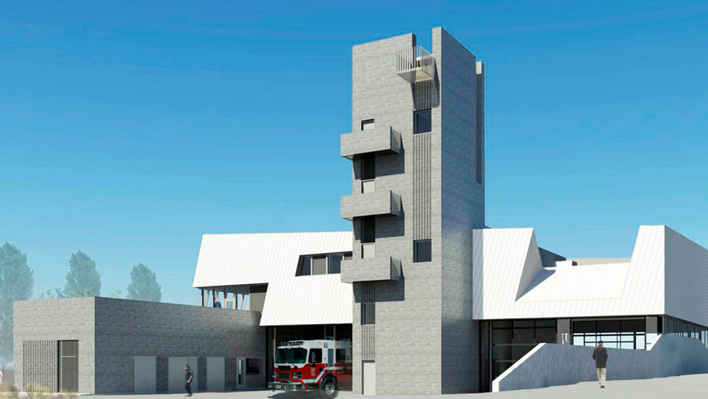 The redesigned zero carbon emission Fire Hall 17 in Vancouver with a four story concrete exterior tower, 4 engine bays, and white metal roof