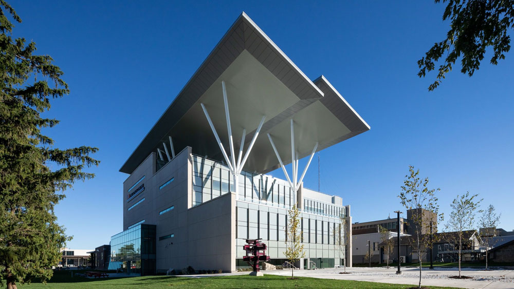 Exterior of the Joyce Center, Ontario, CA, with solar PV arrays and energy efficient glass curtain walls.