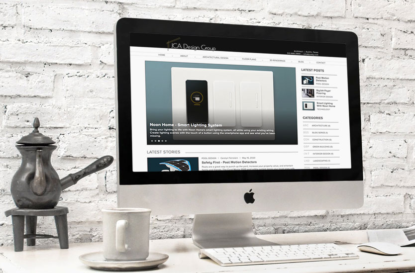Desk with coffee cup and Apple iMac